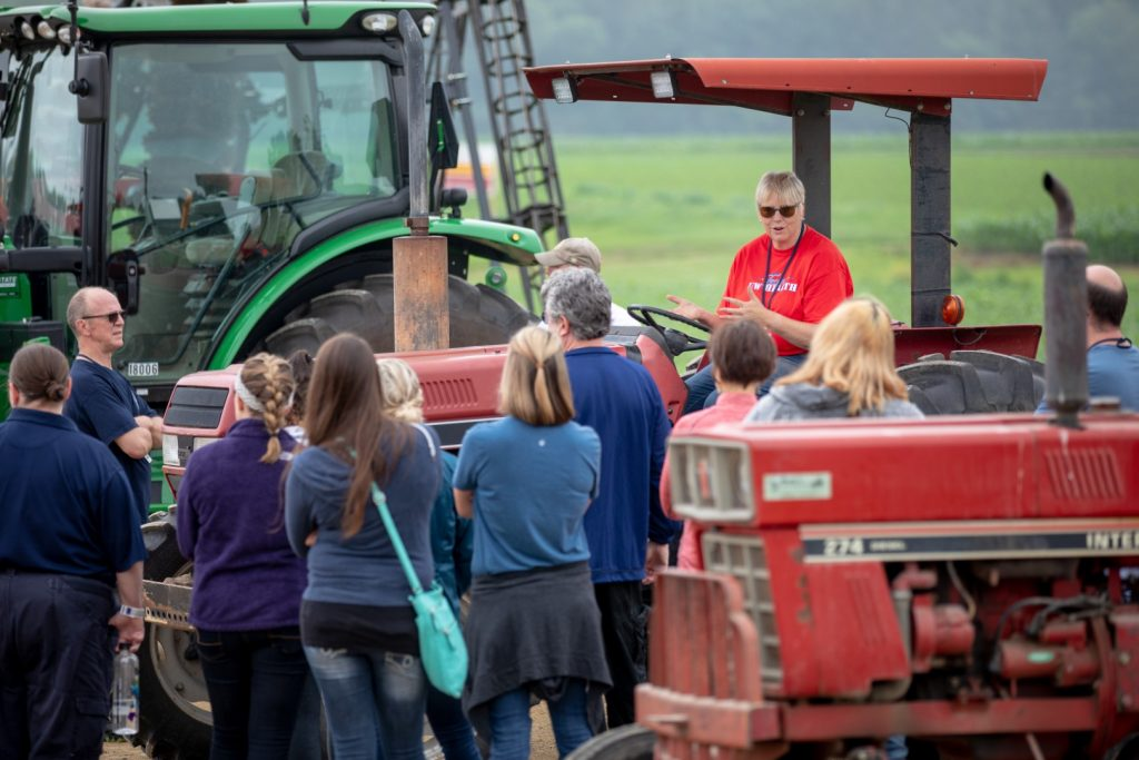 Cheryl Skjolaas talks about tractor safety from the seat of a tractor