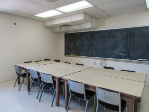 Meeting room with blackboard and table