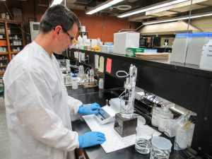 Zach Zopp measuring pH levels in the lab
