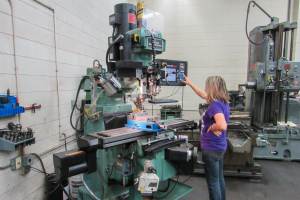 Student using a mill at the machine shop