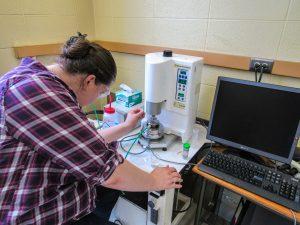Grad student using a rheometer